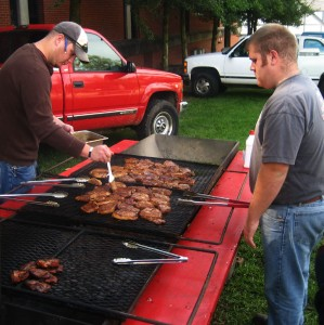 In between classes, Block & Bridle members help grill our famous porkchops.