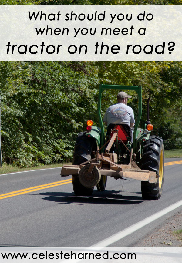 What should you do when you meet a tractor on the road?